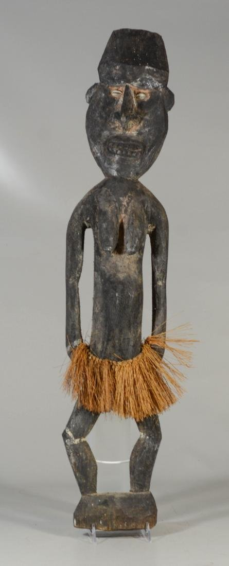 Archaic New Guinea female spirit figure, carved with