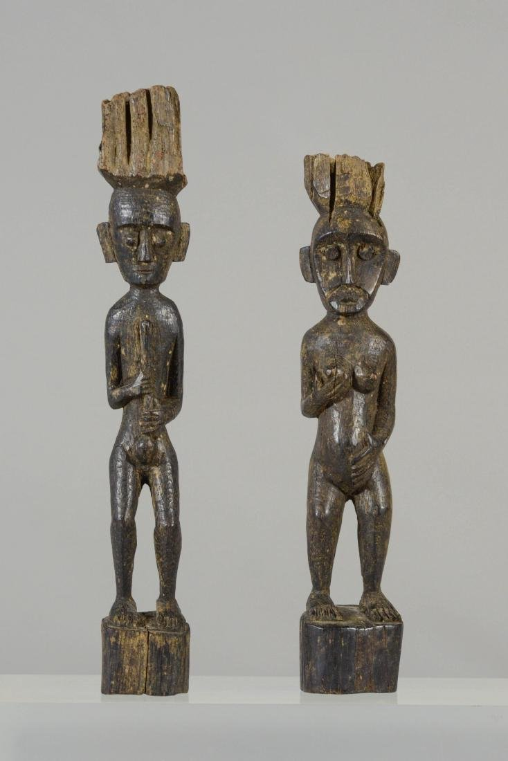 (2) Indonesian Dayak carved wood figures, male &
