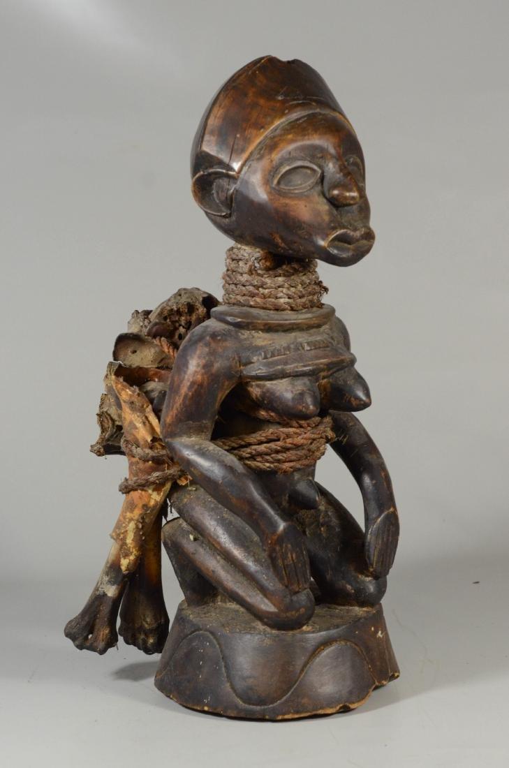 African carved wood kneeling female figure carrying bag