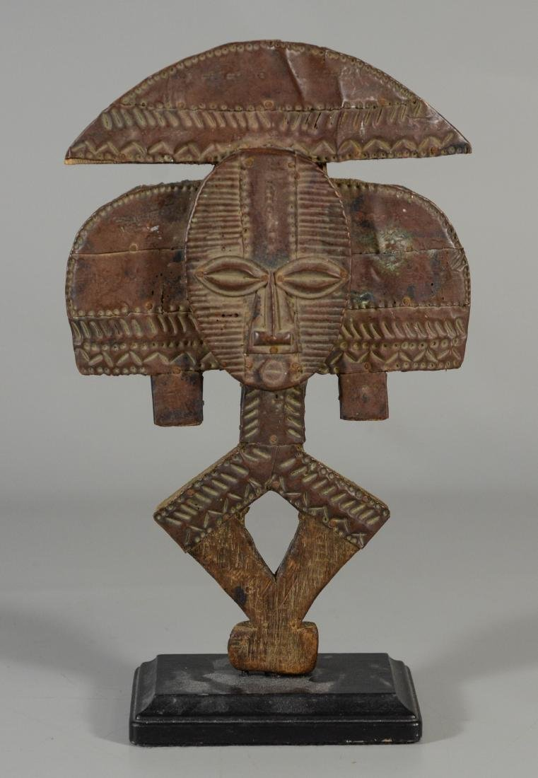 Ethnographic stylized wood carving with embossed metal