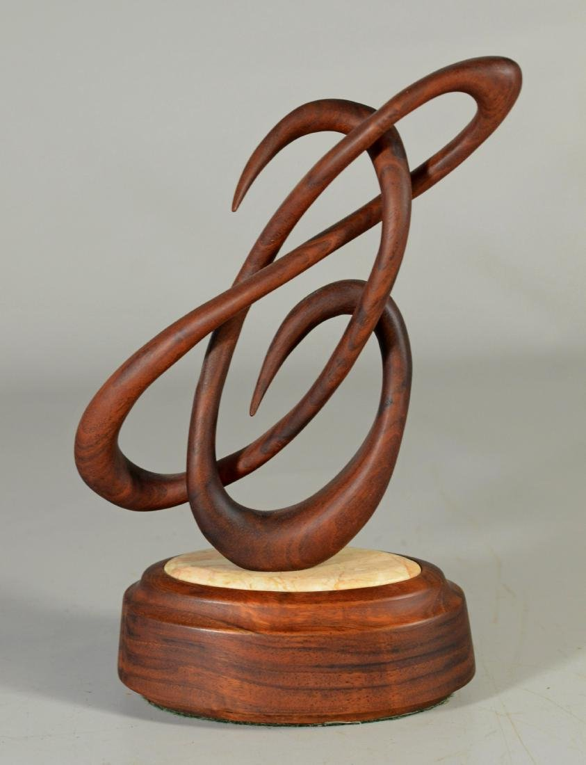 """Wood  and marble sculpture, entitled """"Celebrate"""" and"""