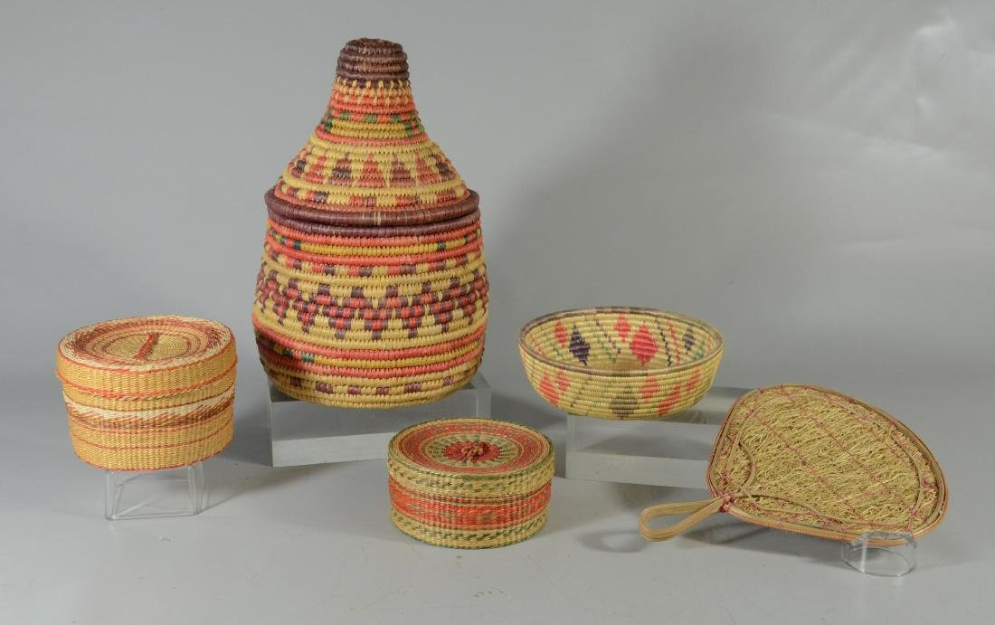 (5) Lot of four multicolored baskets and one fan;