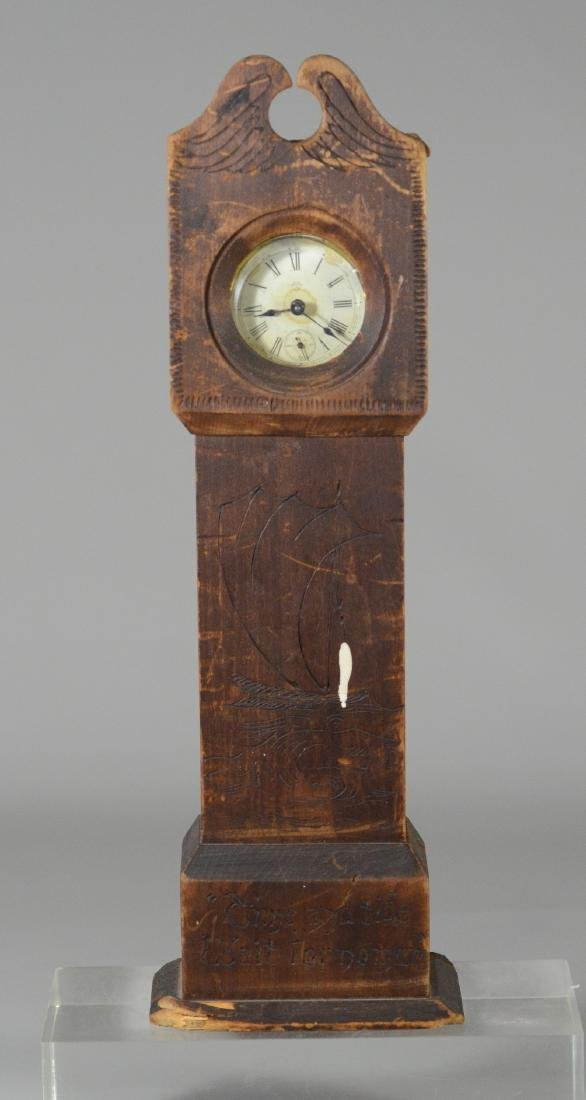 Primitive carved wood watch holder, modeled as a