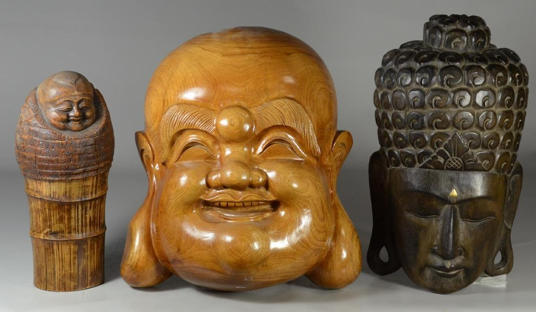 (3) Asian carvings, 2 wooden masks and a bamboo figure,