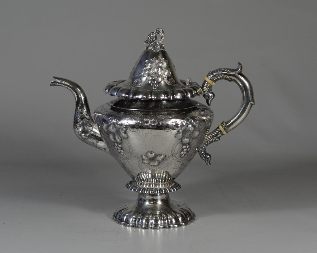 American coin silver repousse teapot, bird head handle