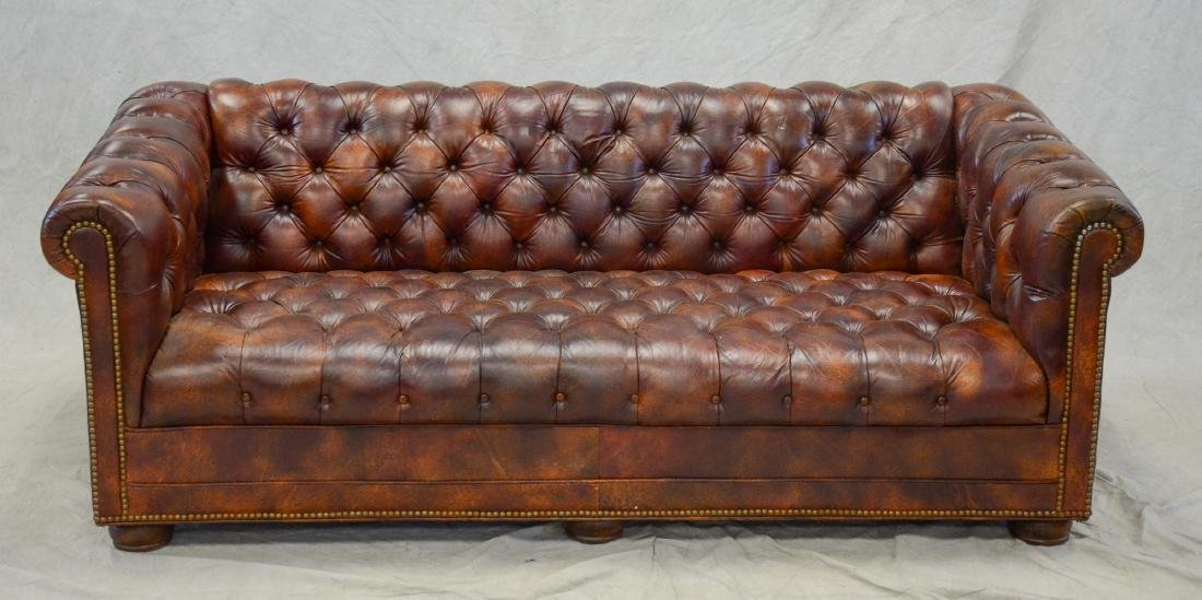 Tufted brown leather Chesterfield sofa