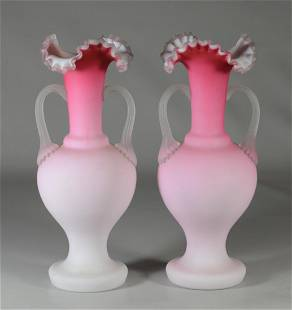 2 pink satin glass vases