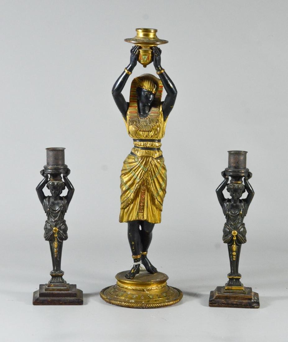 Pr patinated bronze figural candlesticks