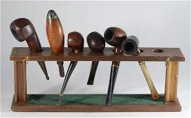 Lot (6) vintage pipes in rack, includes the Longchamp