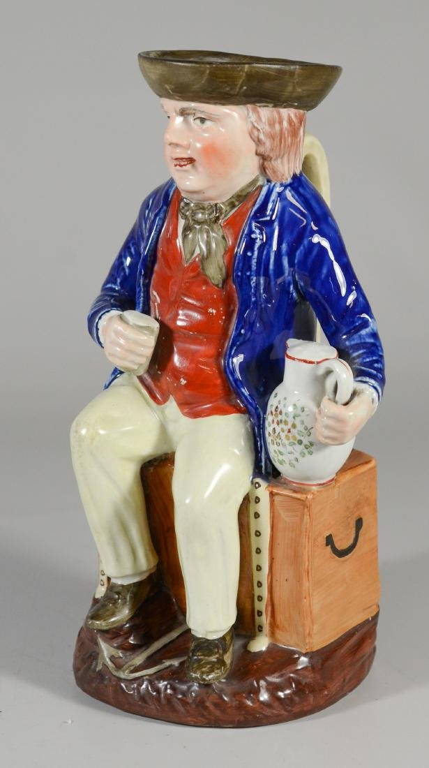 Large unmarked toby jug, sailor seated on trunk