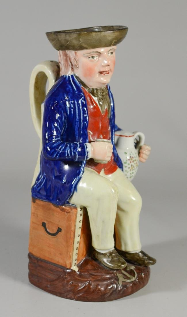 Large unmarked toby jug, sailor seated on trunk - 2