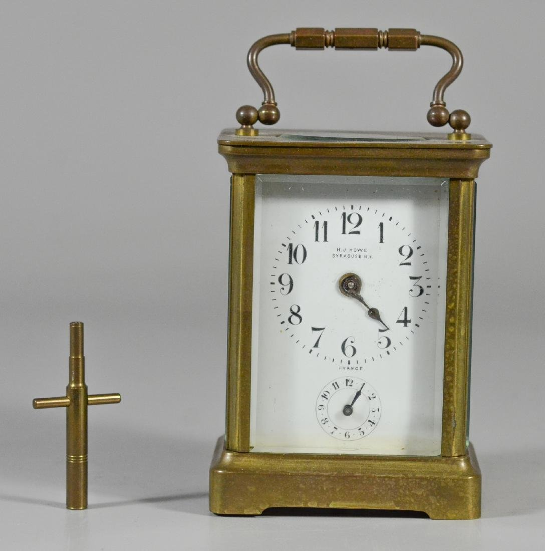 French brass carriage clock, for HJ Howe, Syracuse,