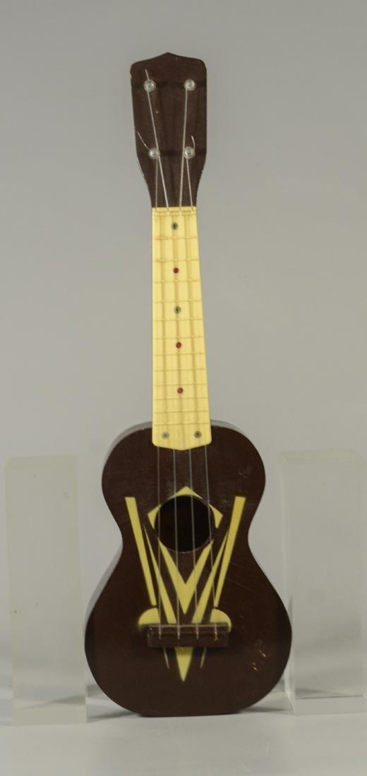 Vintage unmarked ukulele, wood with celluloid frets