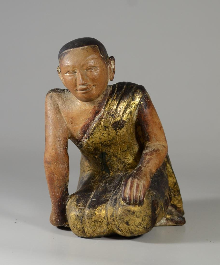 Chinese carved figure of kneeling Buddhist man