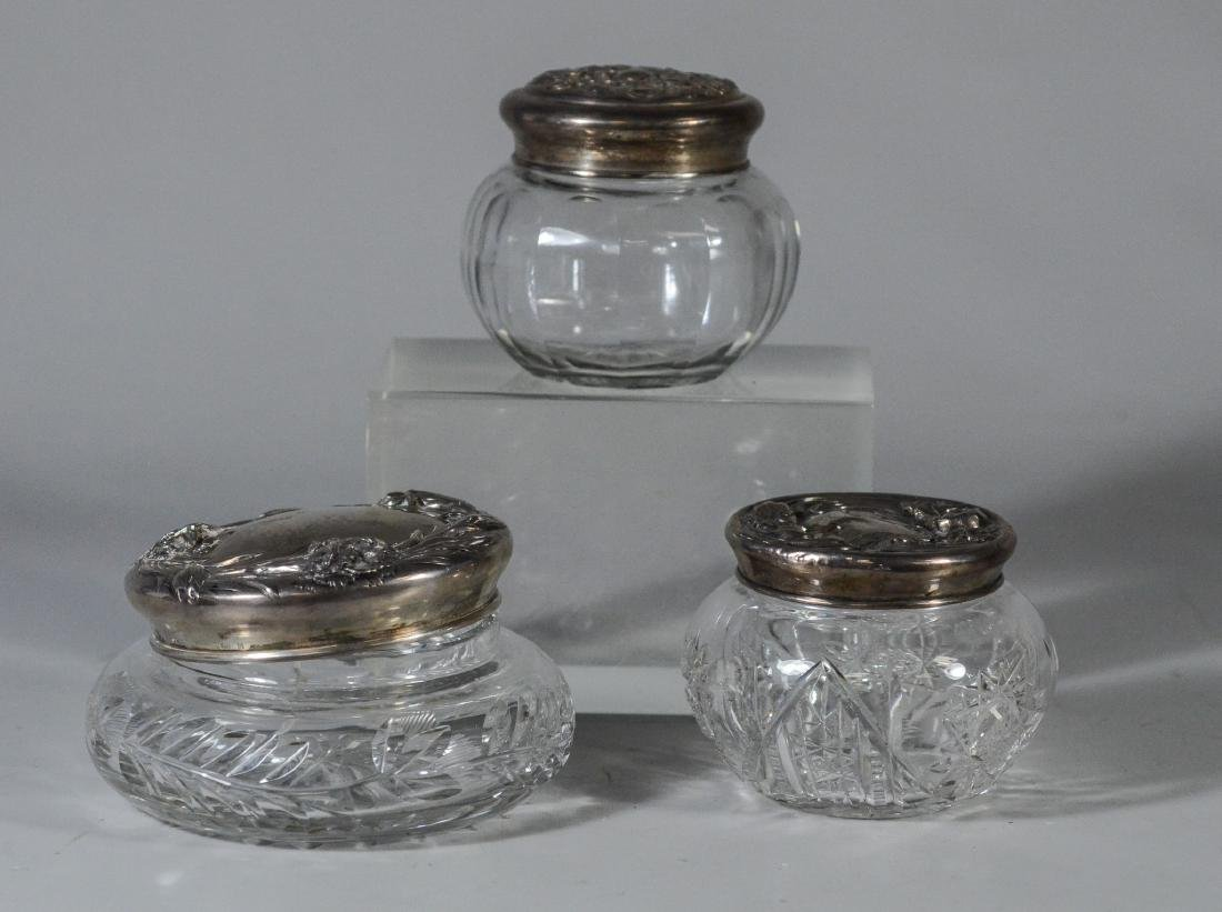 (3) Cut glass sterling topped dresser jars