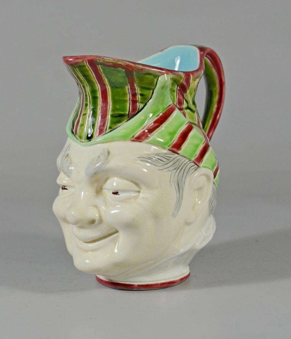 Sarraguemines majolica face jug, man in striped cap