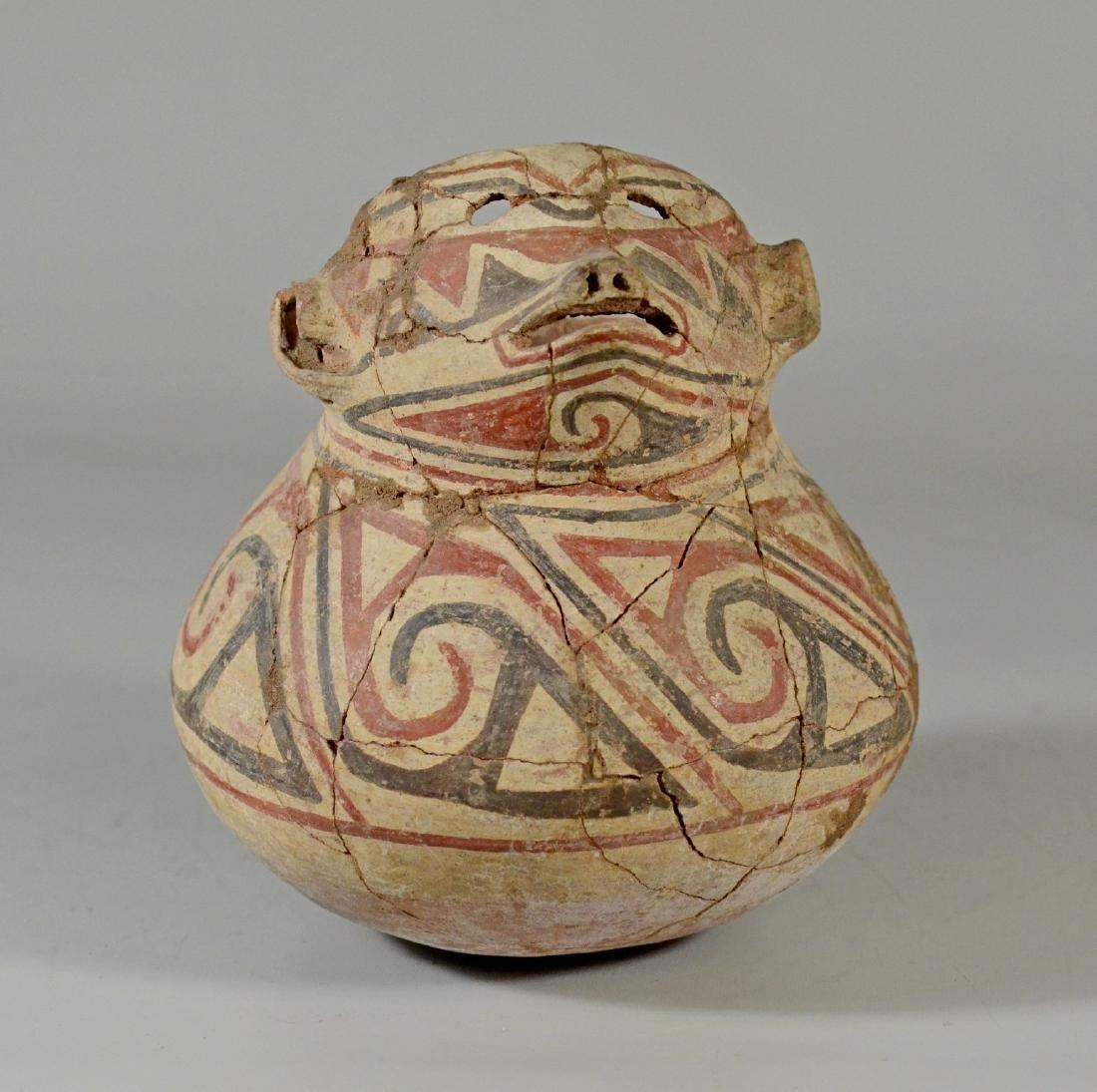 Pre-Columbian figural pot with extensive restoration