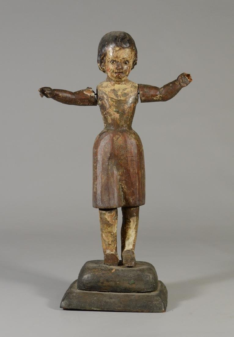 Folk art figure of a young girl arms outstretched