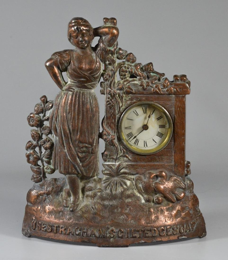 Copper patinated cast iron shelf advertising clock