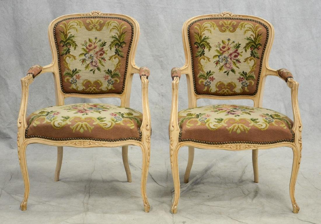 Pair distressed cream painted needlepoint fauteuils,
