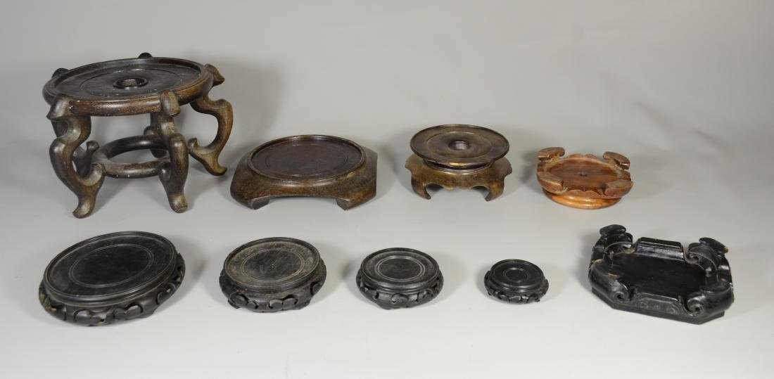 Collection of 9 Asian carved teak vase stands