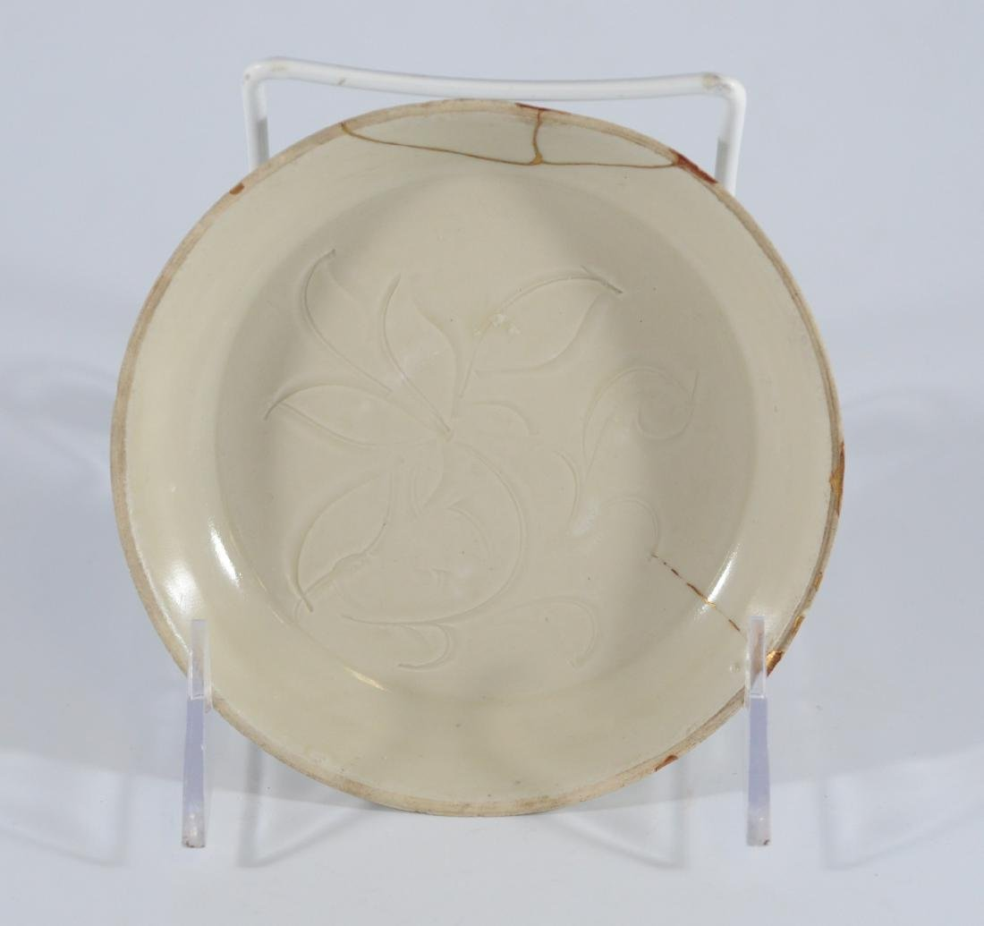 Small Ding carved peony dish with Kintsugi repair, Song