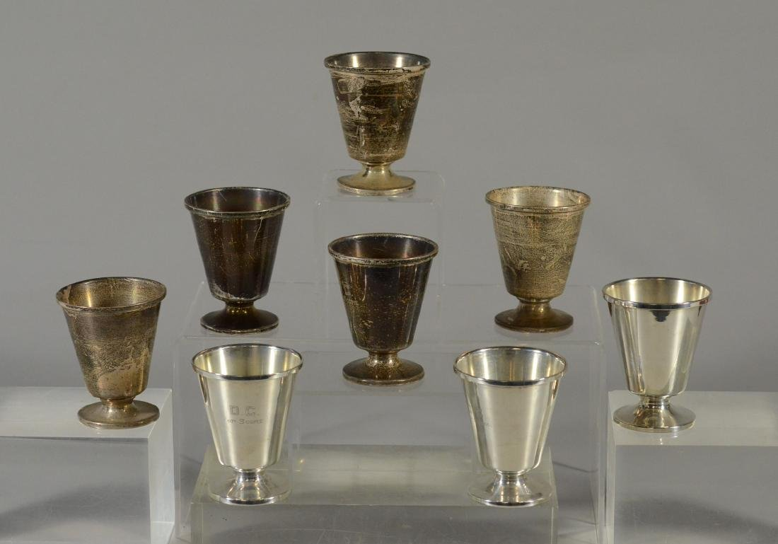 "8 Sterling silver trophy cups marked ""DC Top Score"""
