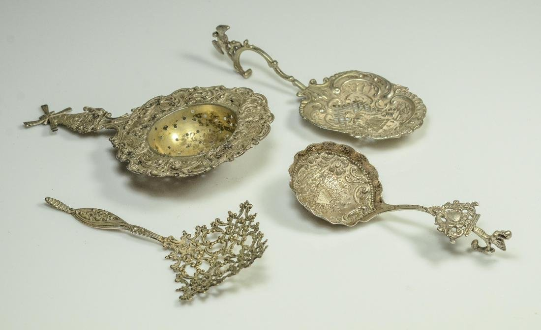 4 Ornate Continental strainers/spoons