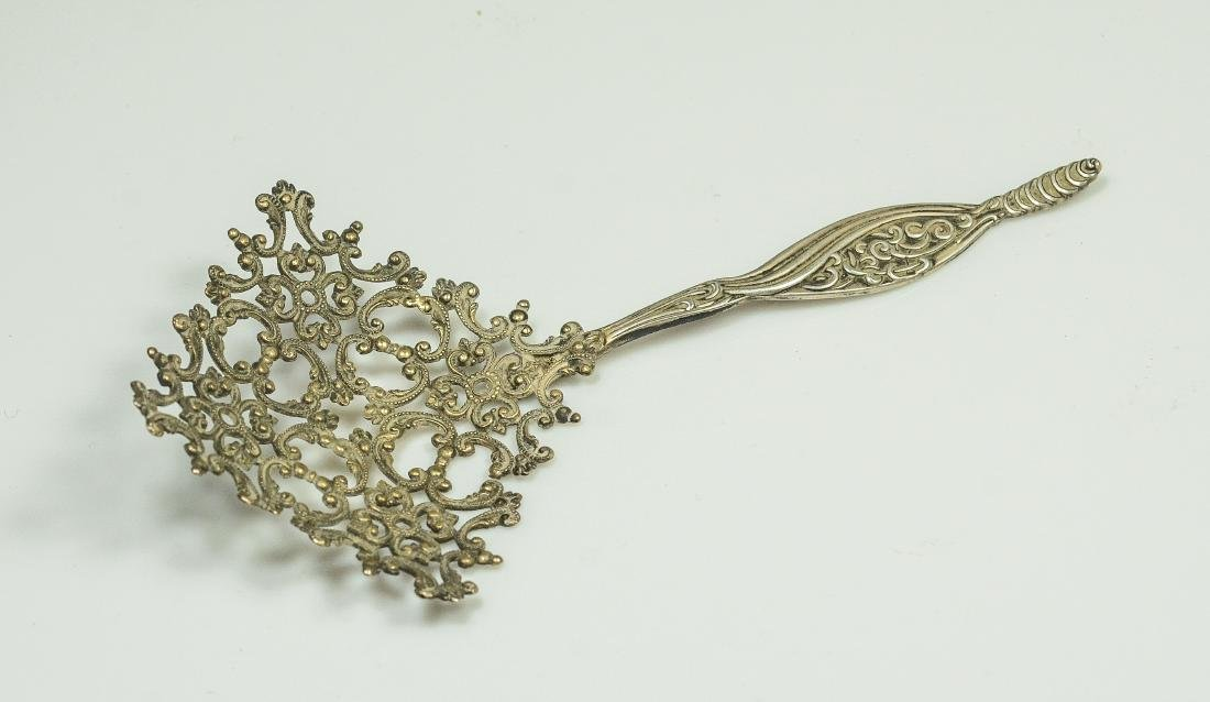 4 Ornate Continental strainers/spoons - 4