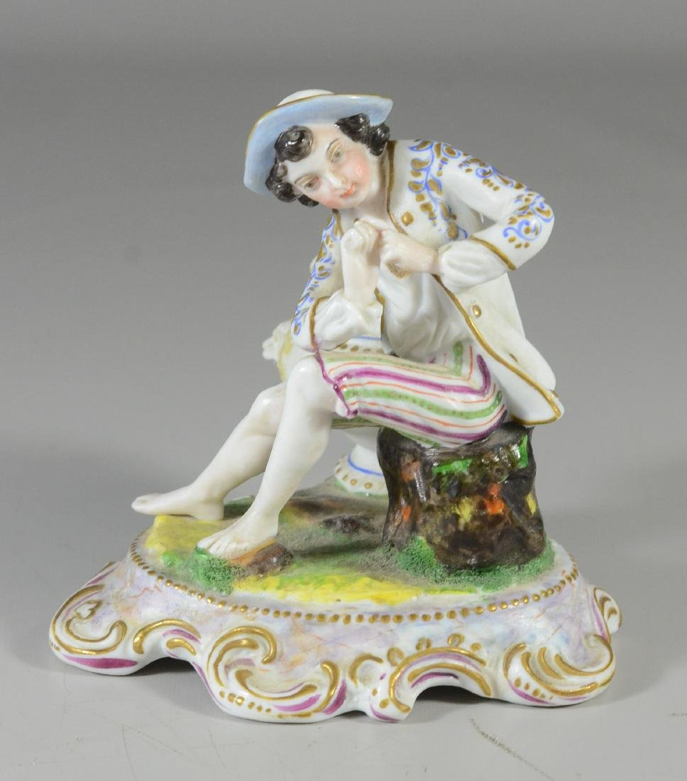 Continental painted bisque figure of a young man