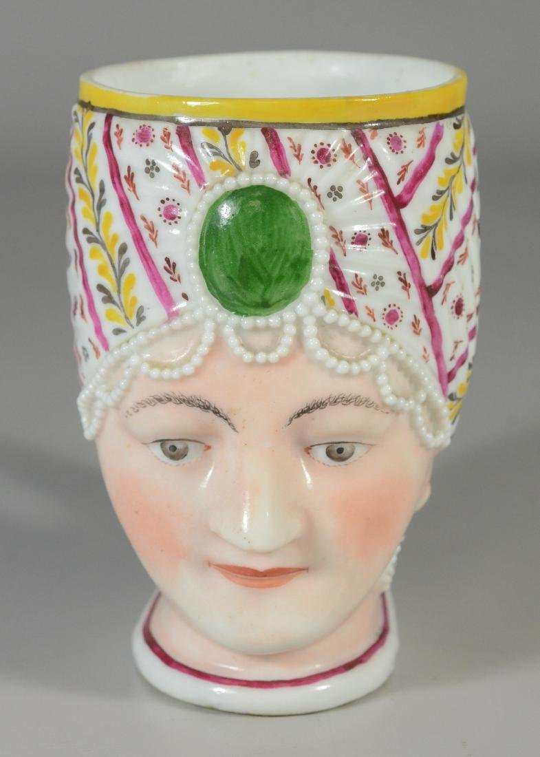 German porcelain covered cup, bust of a woman
