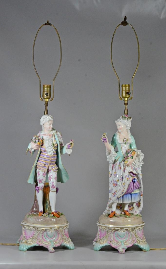 Pair of German porcelain figural candlestick lamps