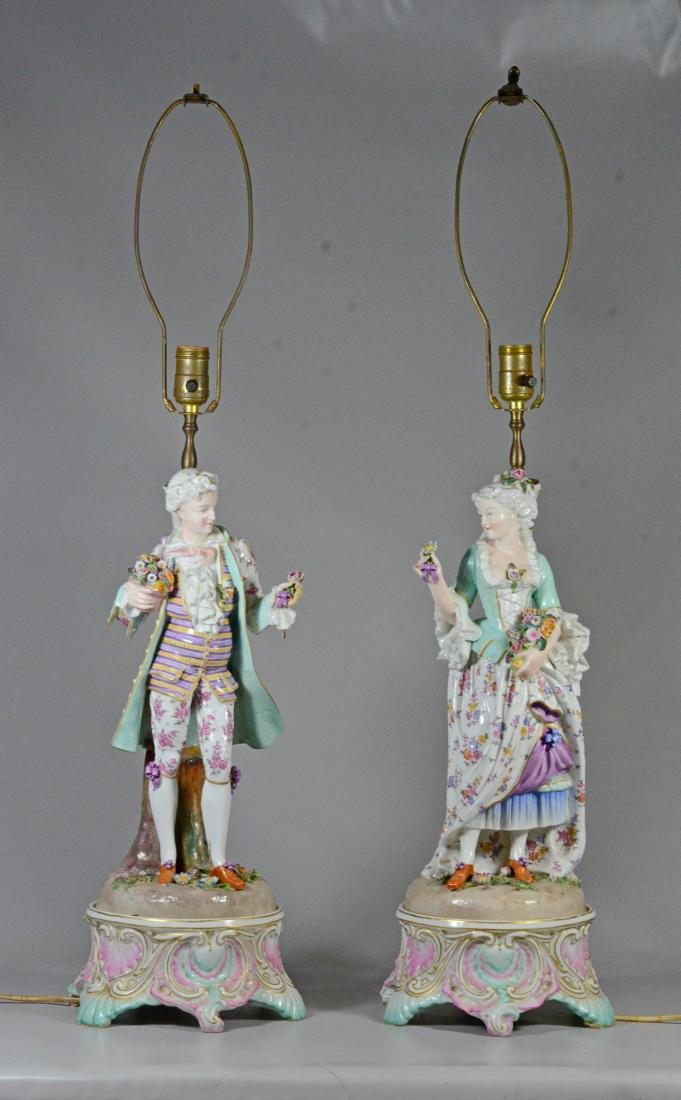 Pair of German porcelain figural candlestick lamps
