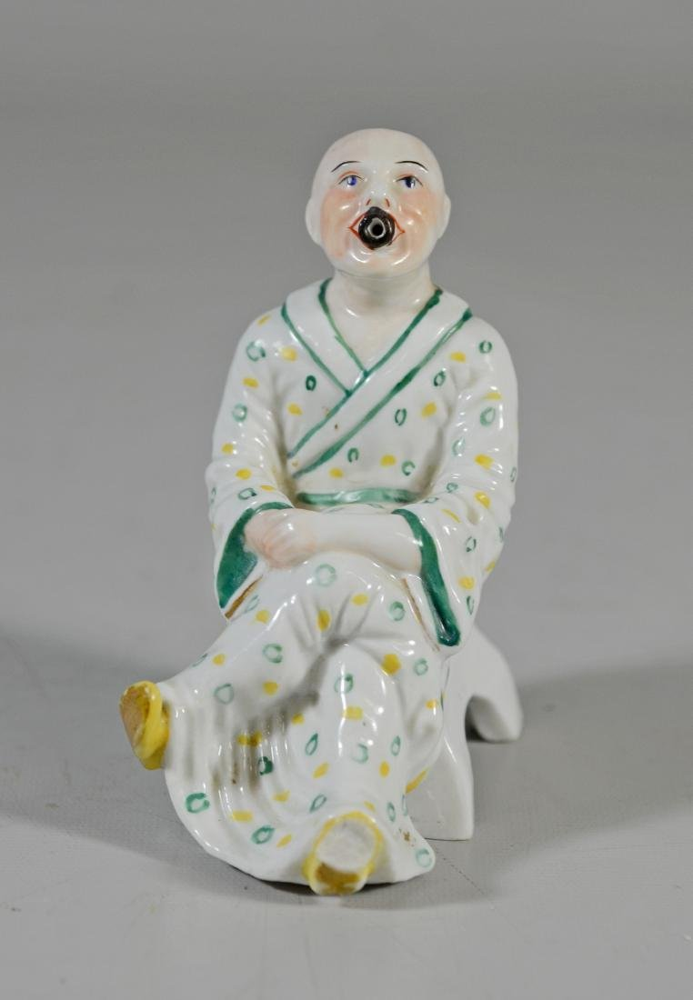Dresden porcelain figural pipe, 20th C, seated Chinaman