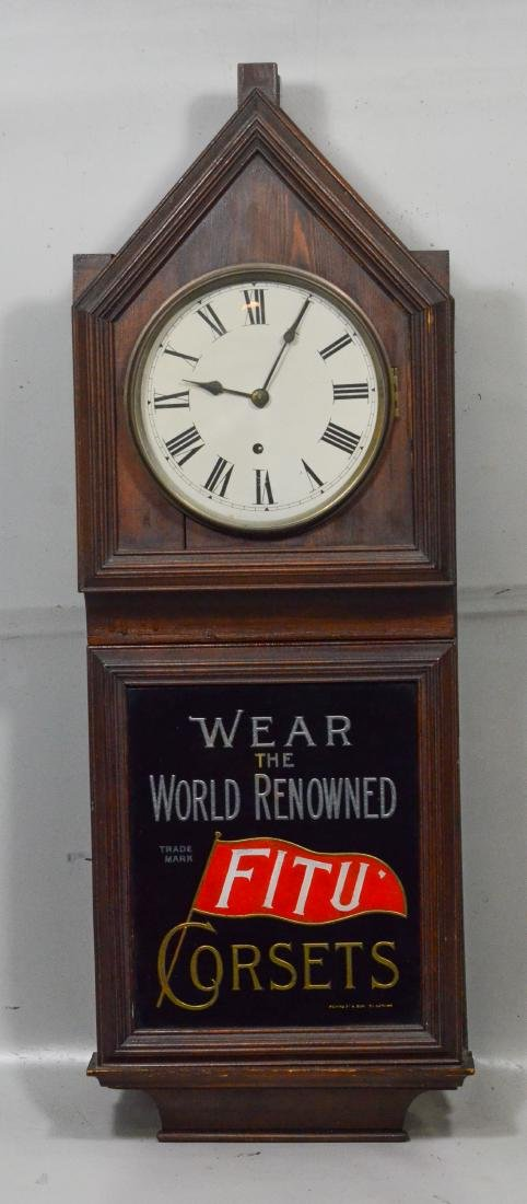 """FitU Corsets"" advertising wall clock, time only"