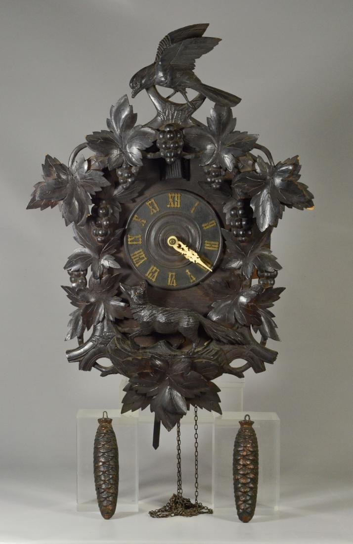 Carved Black Forest cuckoo clock with fox