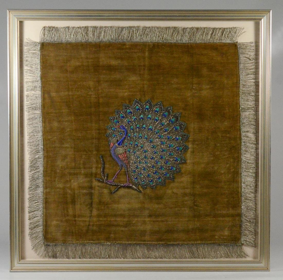 Embroidered silk panel depicting a peacock