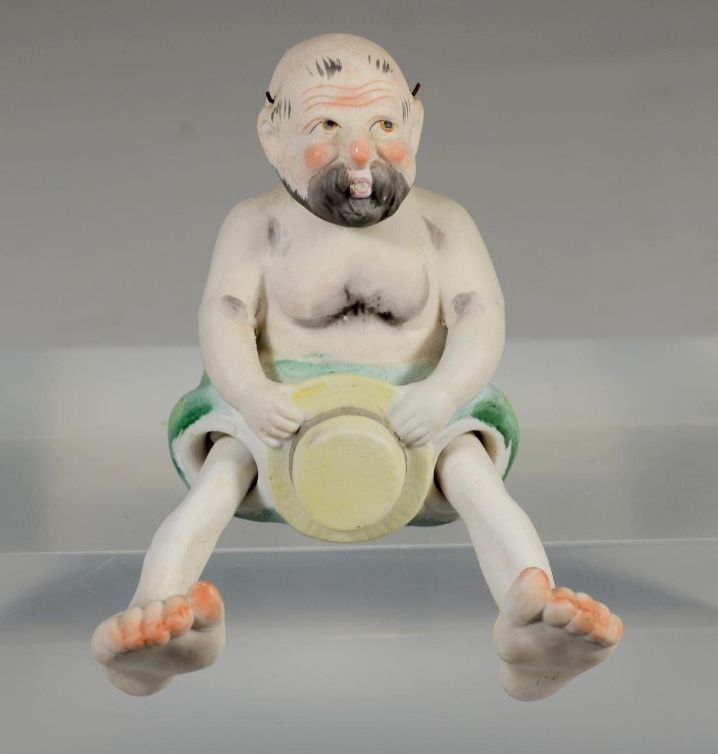 Japanese painted bisque figure of a 'Nodding Pagoda'