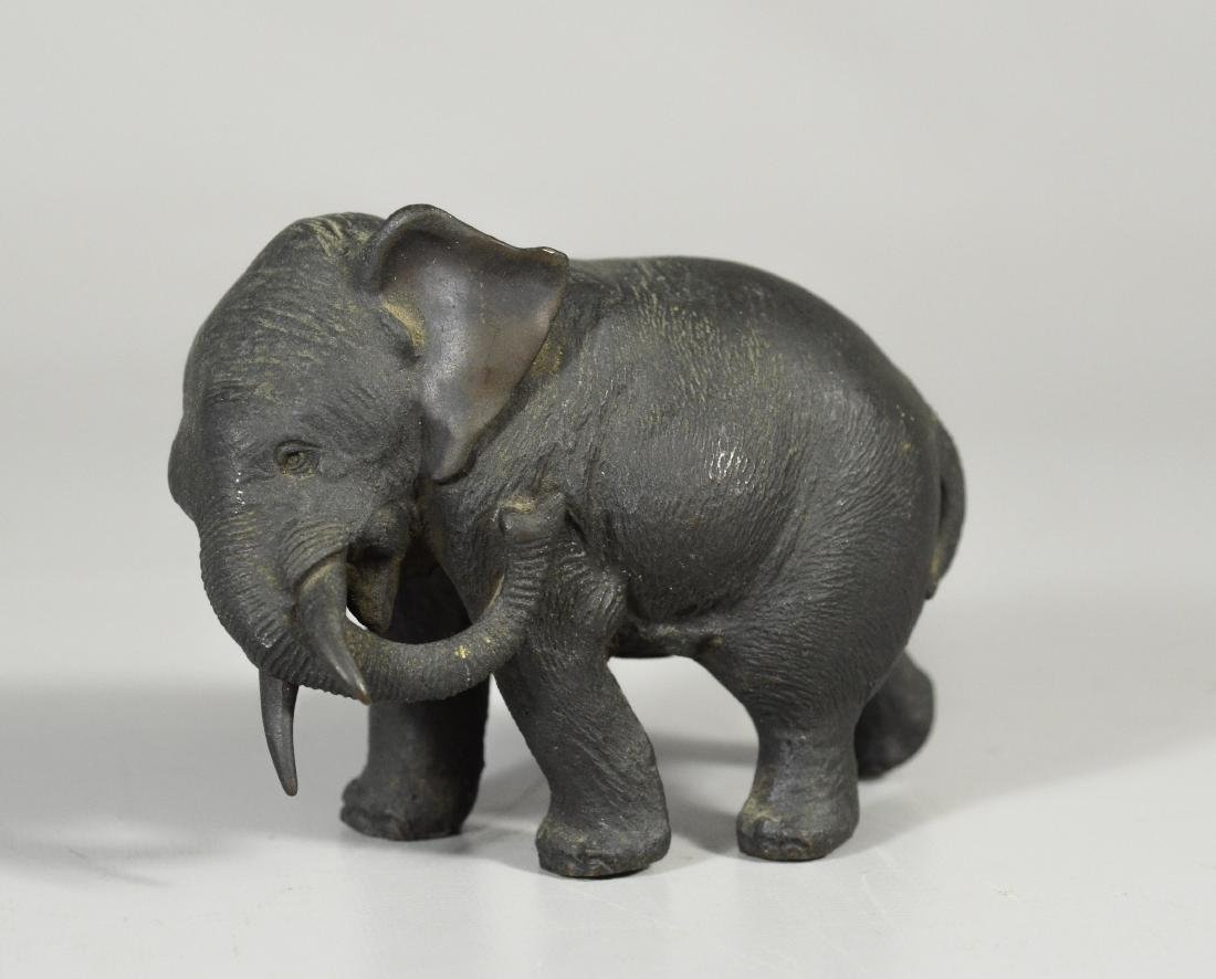 Japanese bronze of an elephant, trunk by his side