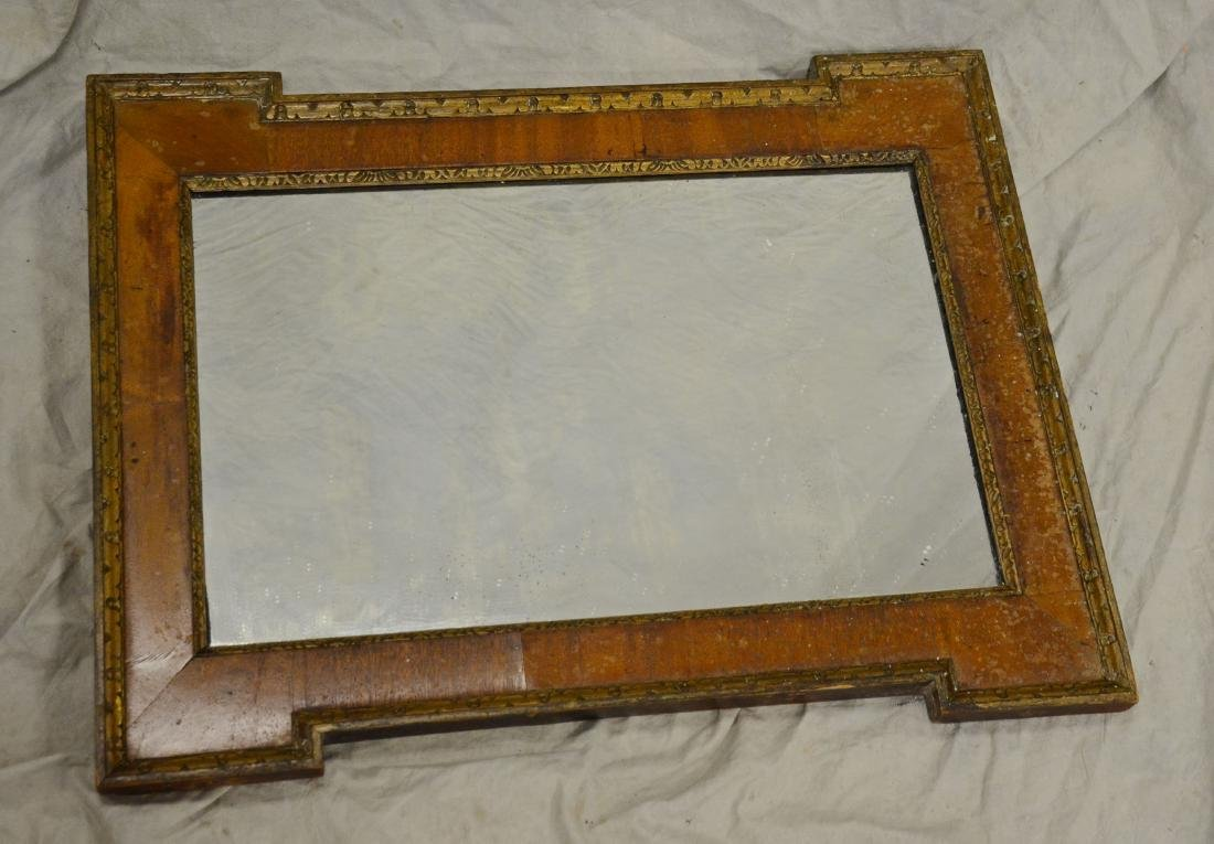Continental mahogany veneer wall mirror, gilt border