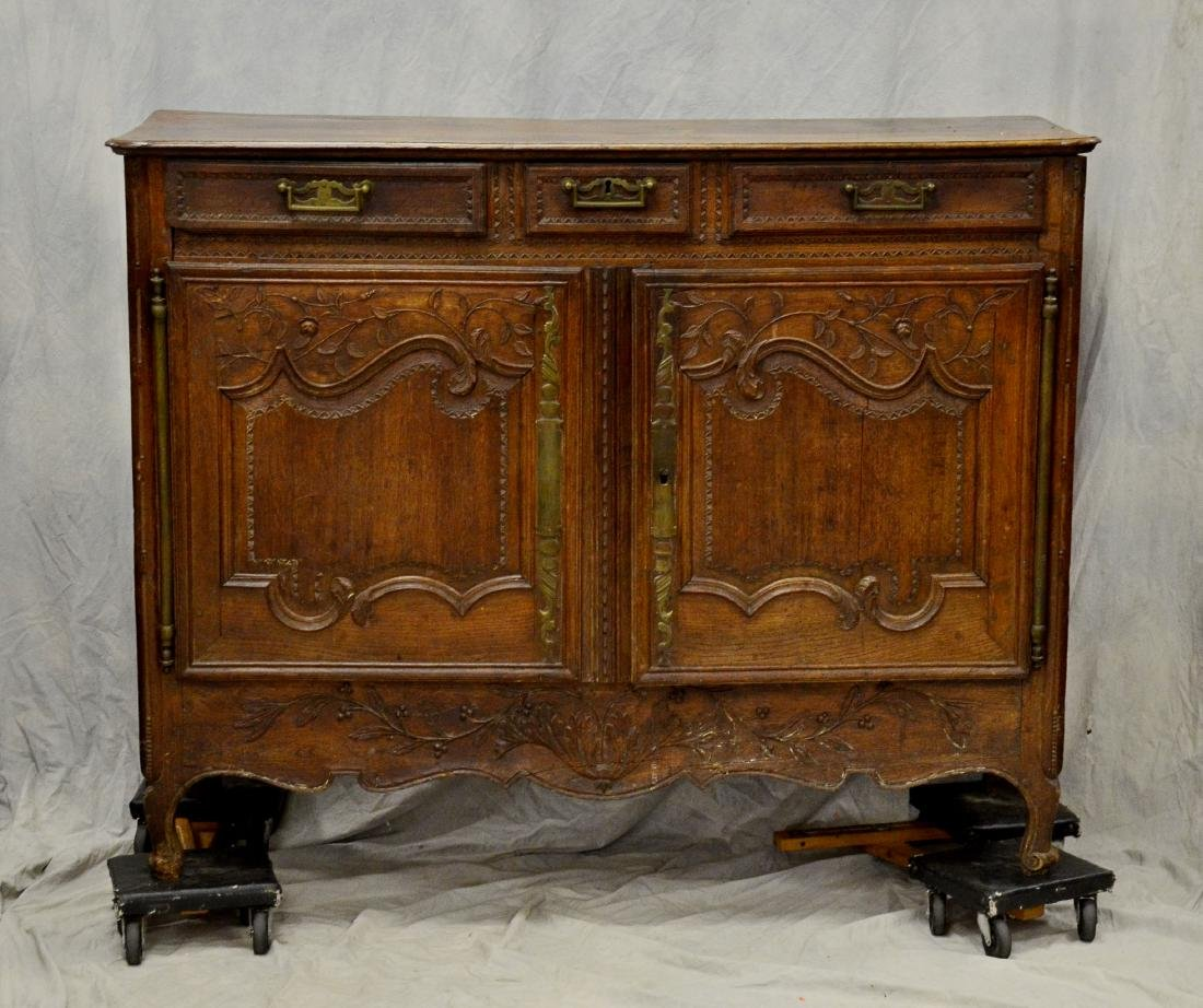 French Provincial carved oak buffet, 18th c, floral