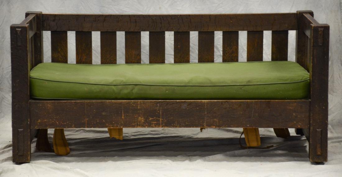 Oak Arts and Crafts even arm sofa, green cushion, un