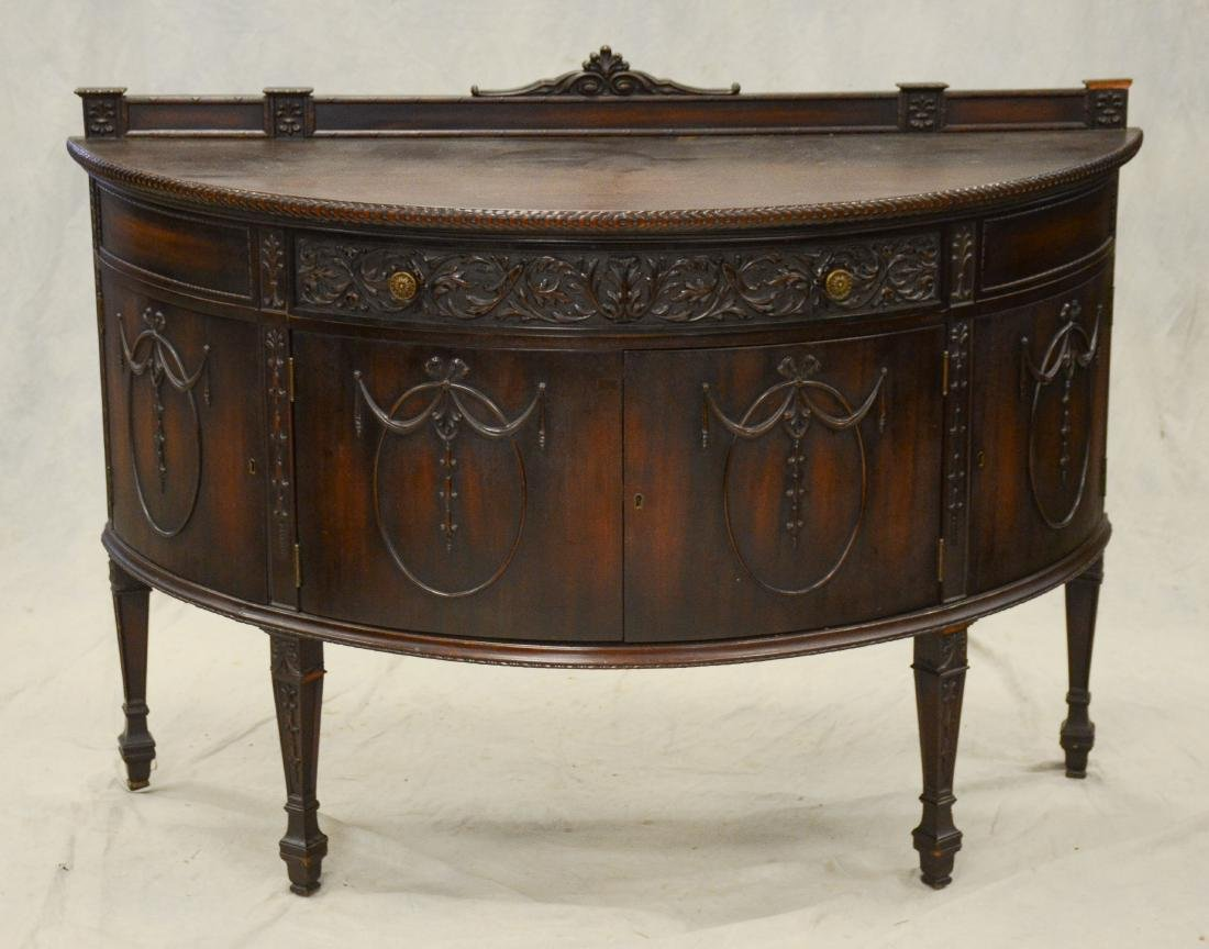 Adams style carved mahogany demilune commode, one dr