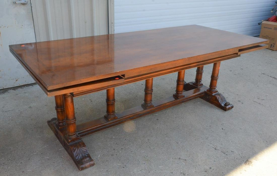 Regency style dining table, plume decoration on feet