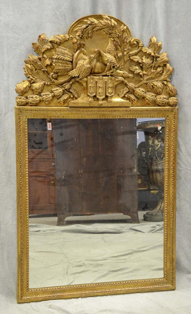 Italian style gilt carved hanging wall mirror, crest