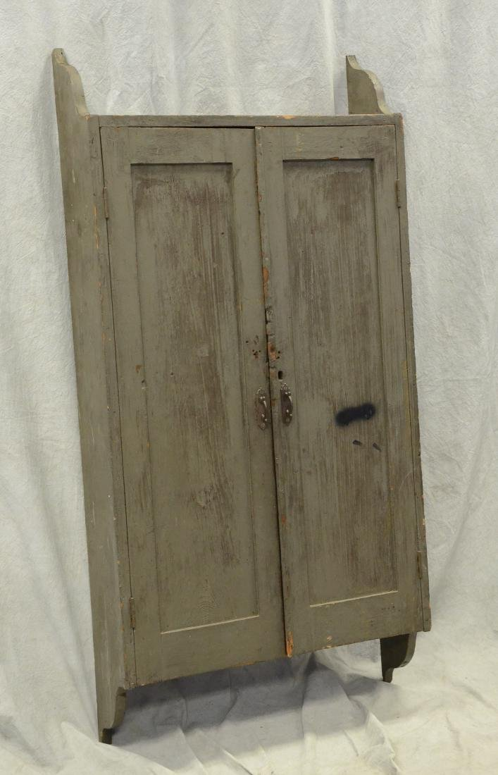 Green painted pine hanging wall cabinet, 19th c