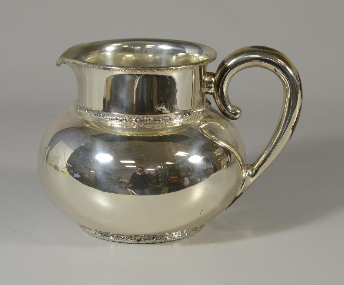 Bigelow Kinnard sterling silver pitcher