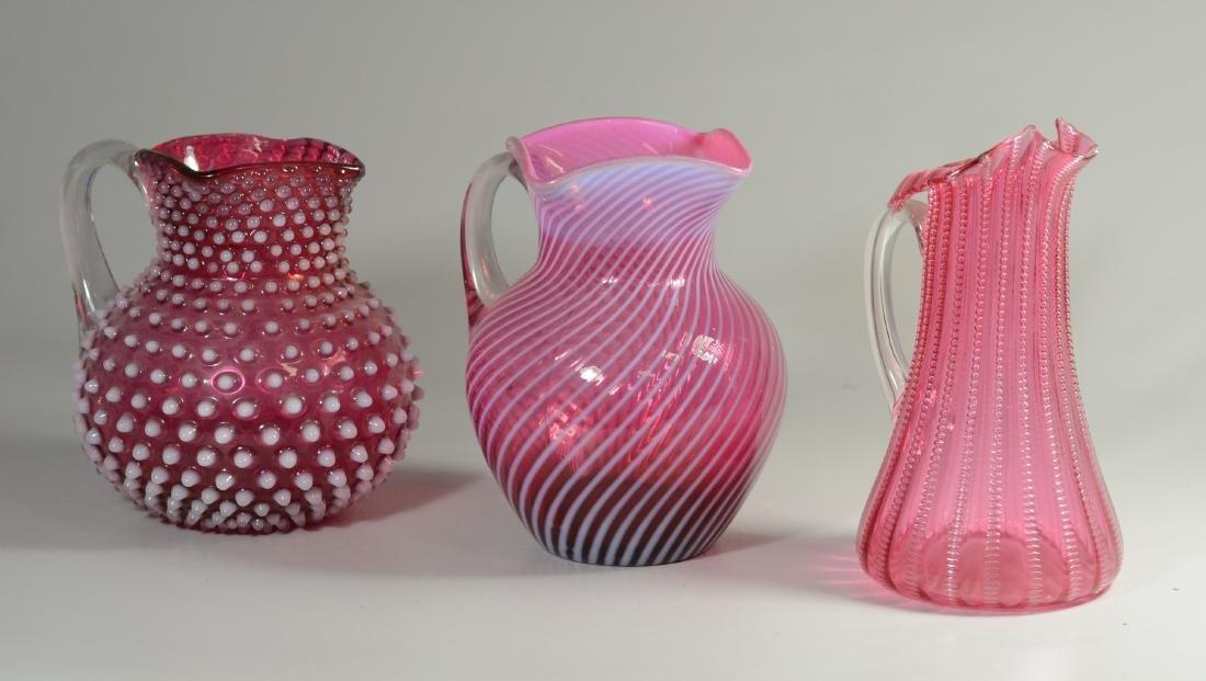 (3) cranberry opalescent American art glass pitchers