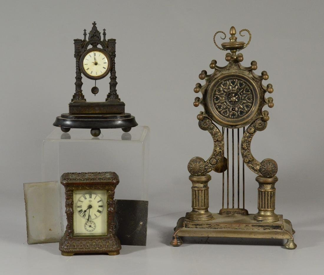 2 small French portico clocks