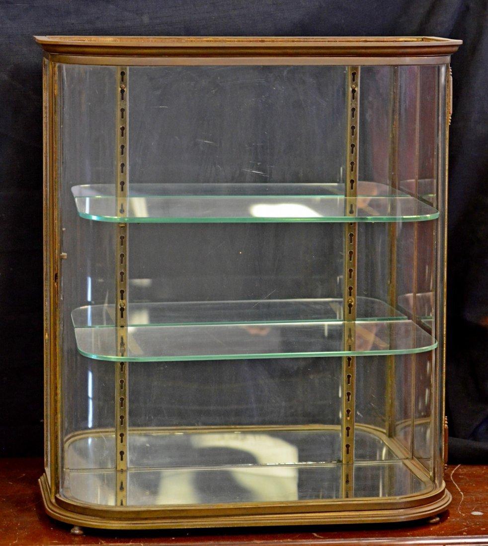 Brass framed curio cabinet